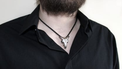 bearded man wearing Hjälte Jewellerys goat skull pendant on a leather string